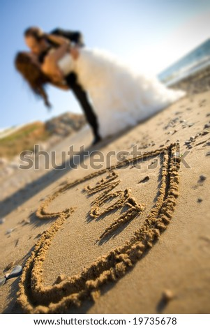 happy wedding couple is kissing on the seaside - stock photo