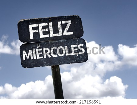 Happy Wednesday (In Spanish) sign with clouds and sky background - stock photo