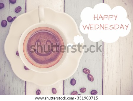 Happy Wednesday with coffee cup on table   - stock photo