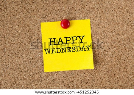 Happy wednesday word with yellow reminder sticky note on cork board - stock photo