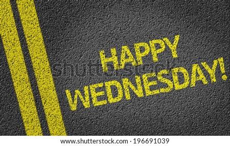 Happy Wednesday written on the road - stock photo