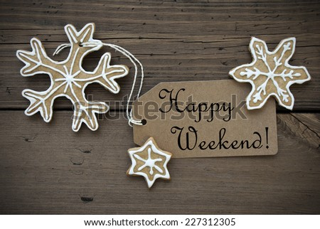 Happy Weekend on a Brown Tag with Ginger Bread Cookies on Wood - stock photo