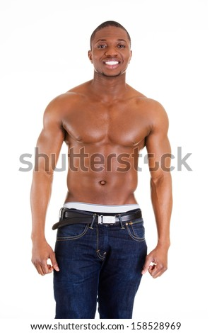 Happy well-built muscular black man in jeans, isolated on white - stock photo