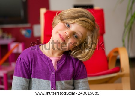 happy white girl in the living room - stock photo