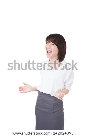 Happy winner - success business woman celebrating screaming and dancing of joy after winning something. mixed race Chinese Asian / Caucasian cheerful over her success. Isolated on white background. - stock photo