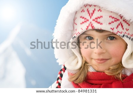 Happy winter vacation - winter child portrait (space for text) - stock photo