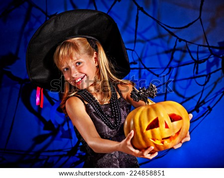 Happy witch child at Halloween party. - stock photo