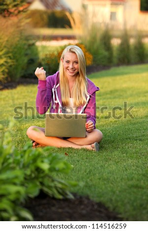 Happy with her computer - stock photo