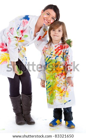 Happy woman and a kid painting with robes and smiling - isolated - stock photo