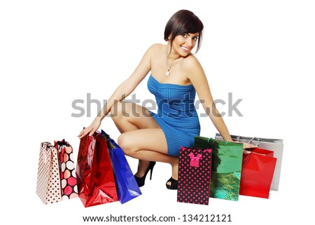 Happy woman and a lot of shopping bags