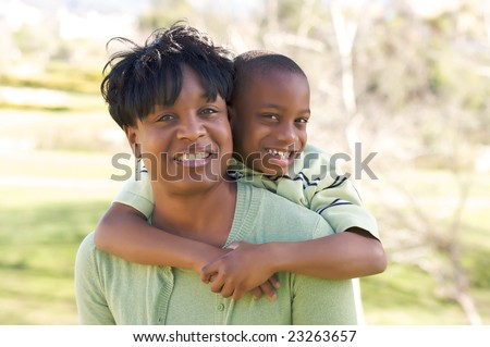 Happy Woman and Child having fun in the park. - stock photo