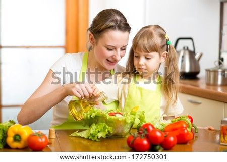 Happy woman and child preparing healthy food together - stock photo