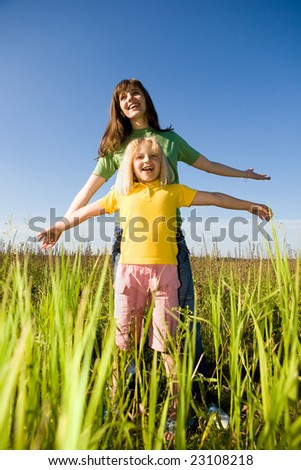 Happy woman and girl - stock photo