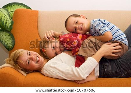 Happy woman and kids having fun indoors - stock photo