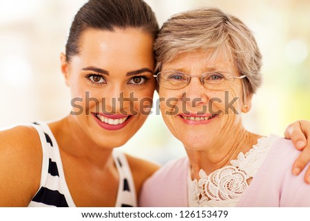 happy woman and senior mother closeup portrait - stock photo
