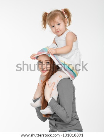 Happy woman and young girl (child) in bed smiling. Mother day concept - stock photo