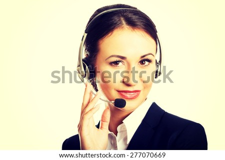 Happy woman as a phone operator in headset. - stock photo