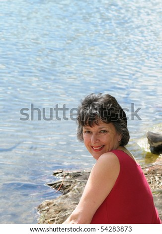 Happy woman at a lake