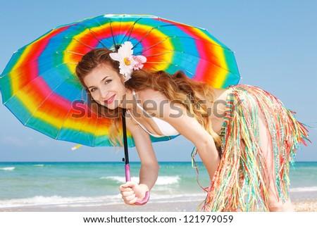 Happy woman at the beach enjoying vacation - stock photo