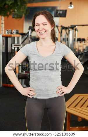 Happy woman at the gym after training