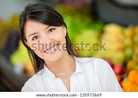Happy woman at the local market smiling - stock photo