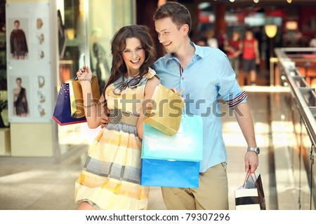 Happy woman at the shopping center - stock photo