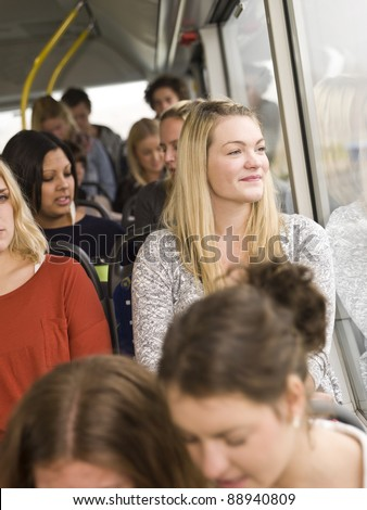 Happy woman at the window on a bus