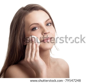 Happy woman caring about her fresh healthy skin of face with cotton swab disk - white background - stock photo