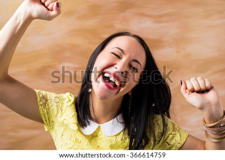 Happy woman celebrating with hands up  - stock photo