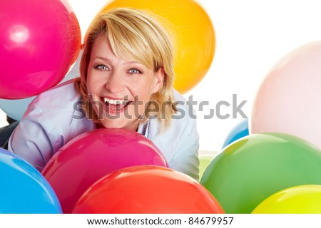 Happy woman celebrating with many colorful balloons - stock photo