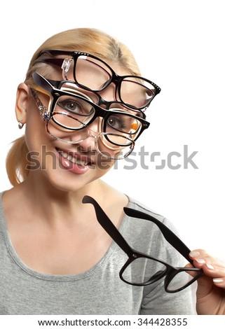 Happy woman chooses eyewear - stock photo