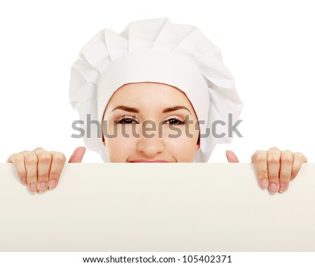 Happy woman cook or baker holding over paper sign billboard.