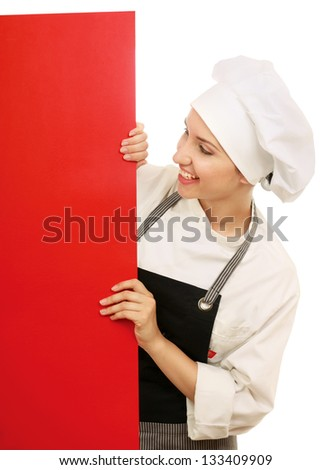Happy woman cook or baker holding over paper sign billboard. - stock photo