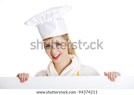 Happy woman cook or baker looking over paper sign billboard. Caucasian woman isolated on white background. - stock photo
