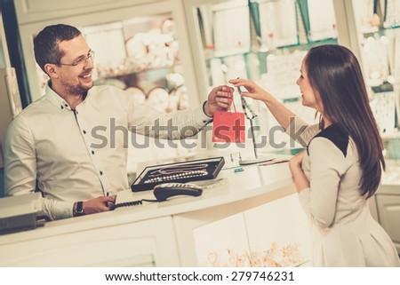 Happy woman customer in a jewellery shop  - stock photo