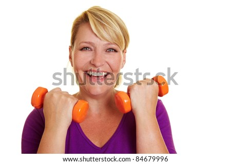Happy woman doing fitness exercises with dumbbells