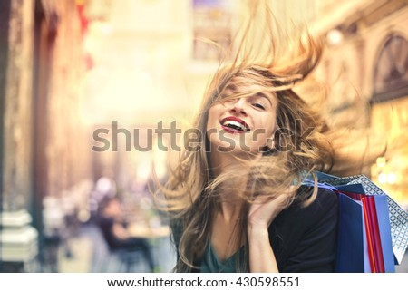 Happy woman doing shopping - stock photo