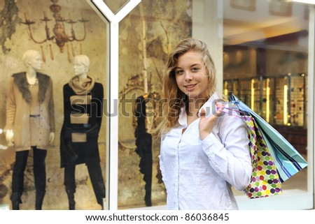 happy woman doing shopping smiling