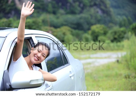 happy woman driver sit in the car give salute gesture  - stock photo
