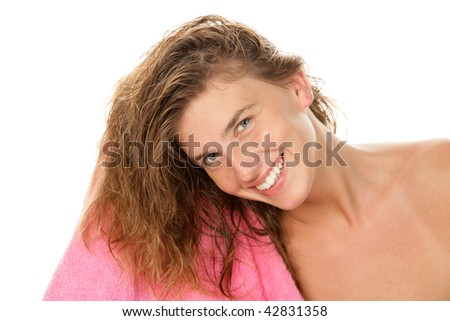 Happy woman drying hair with towel isolated on white background - stock photo