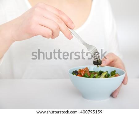 happy woman eating a healthy vegetarian food vegetable salad - stock photo