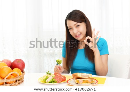 Happy woman eating meals