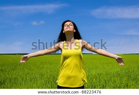 Happy woman enjoy sun in the field. Freedom feelings - stock photo