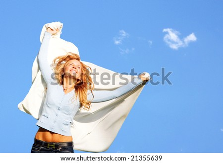 happy woman enjoying her freedom and success - stock photo