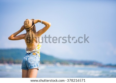 Happy woman enjoying sea view - stock photo