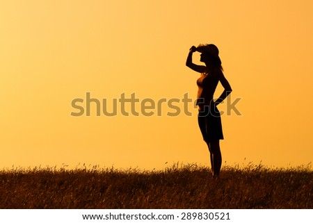 Happy woman enjoys in sunset.Peace of mind in nature - stock photo