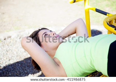 Happy woman exercising outdoors - stock photo