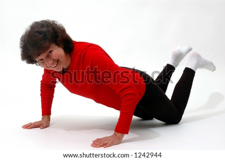 happy woman exercising push up - stock photo