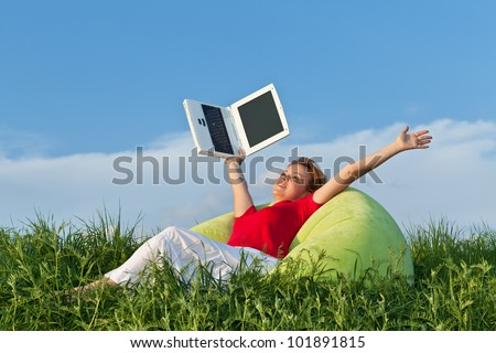 Happy woman free from work stretching her arms outdoors - stock photo