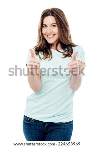 Happy woman gesturing double thumbs up - stock photo
